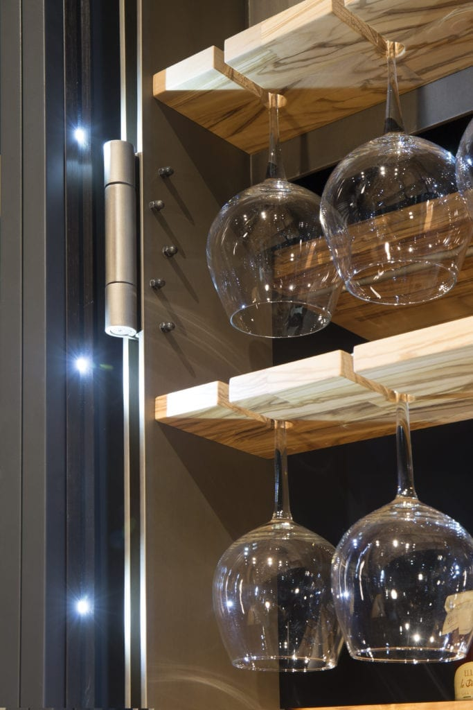Solid bronze fittings and interior lighting are bespoke details. Cabinetry can be made to the exact specifications for stemware and kitchenware collections, wine storage and more.