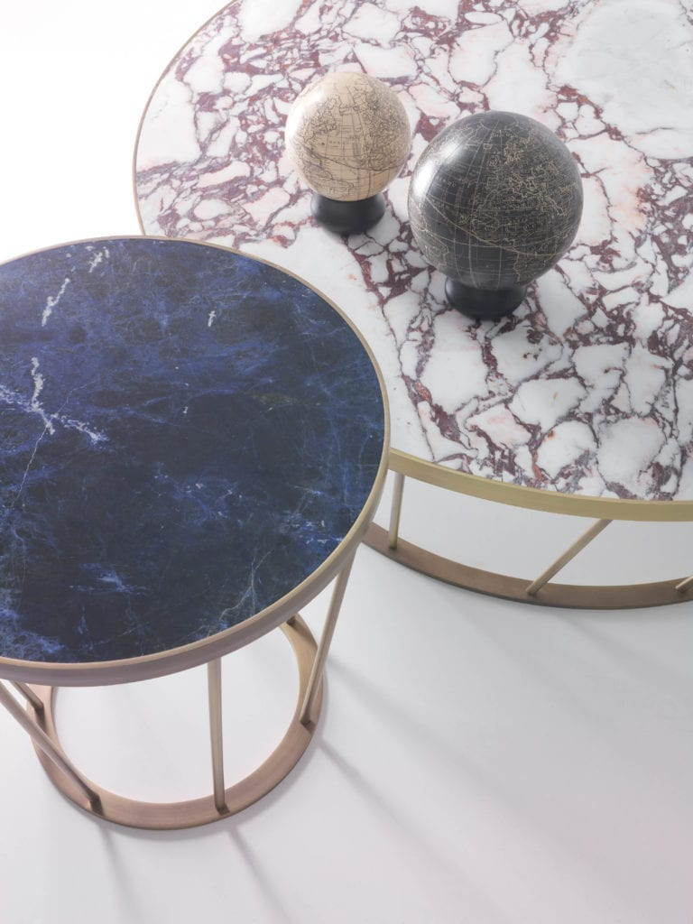 Kreoo Dora coffee tables shown in exotic Calacatta Viola marble and Blue Sodalite