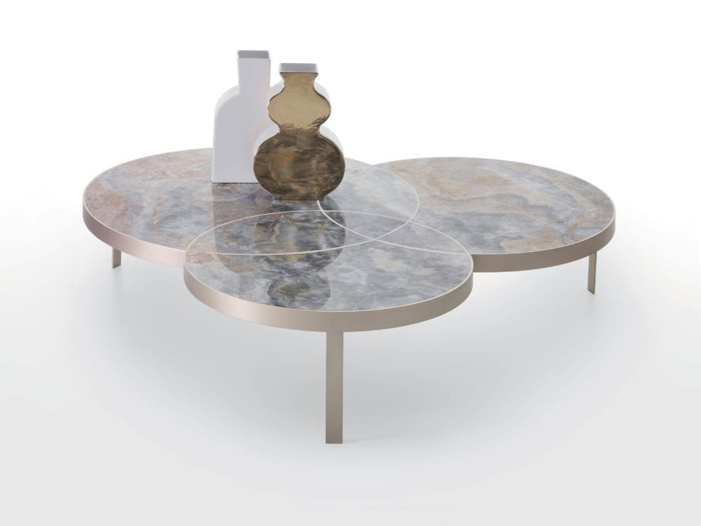 Kreoo's new Jackie cocktail table shown in Light Sky Onyx and opaque brass.