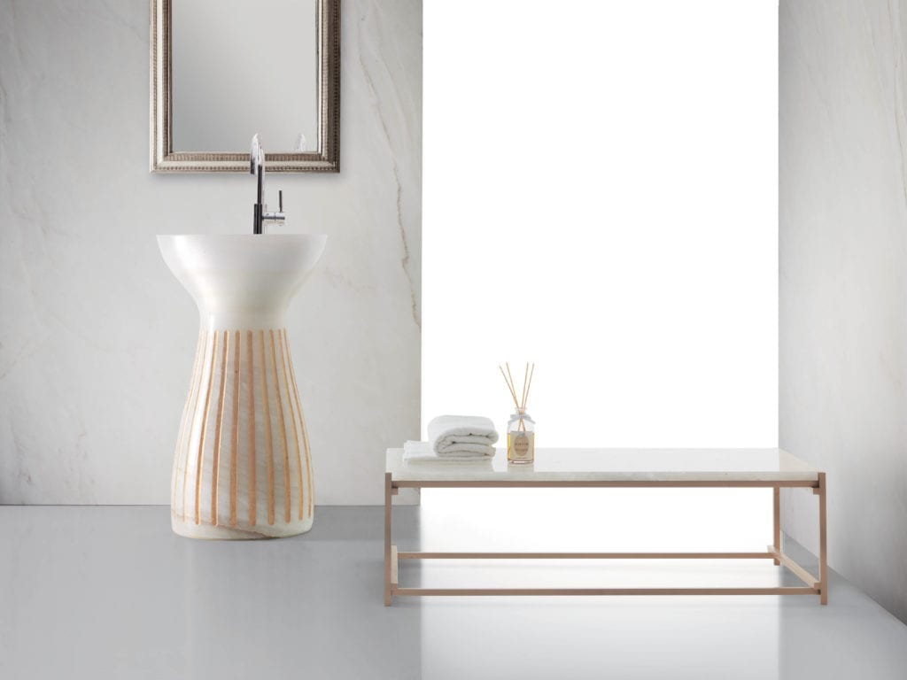The new Kreoo Roma sink by Marco Piva in Bianco Onyx with gold leaf detail.
