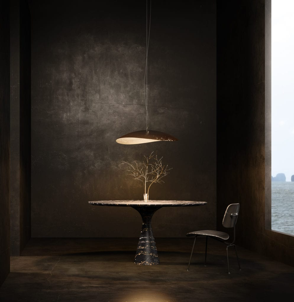 Torre Portoro luxury stone dining table under a hanging lamp