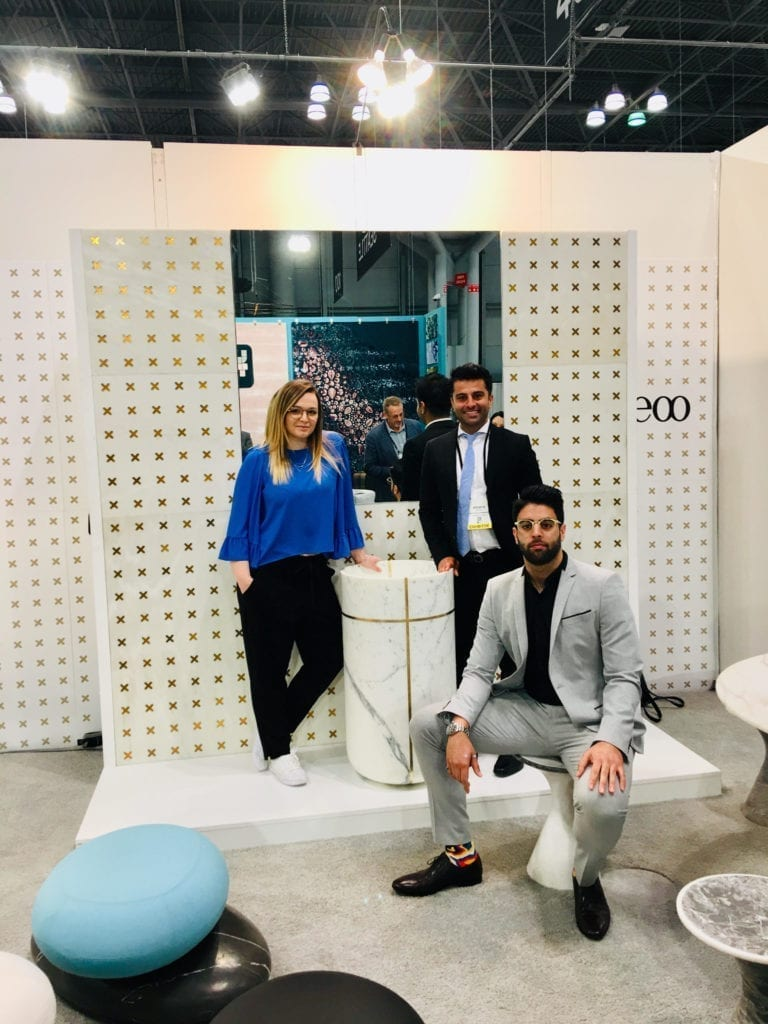 The Davani team at ICFF in New York with the Ducale Bianco Del Rey marble wall.