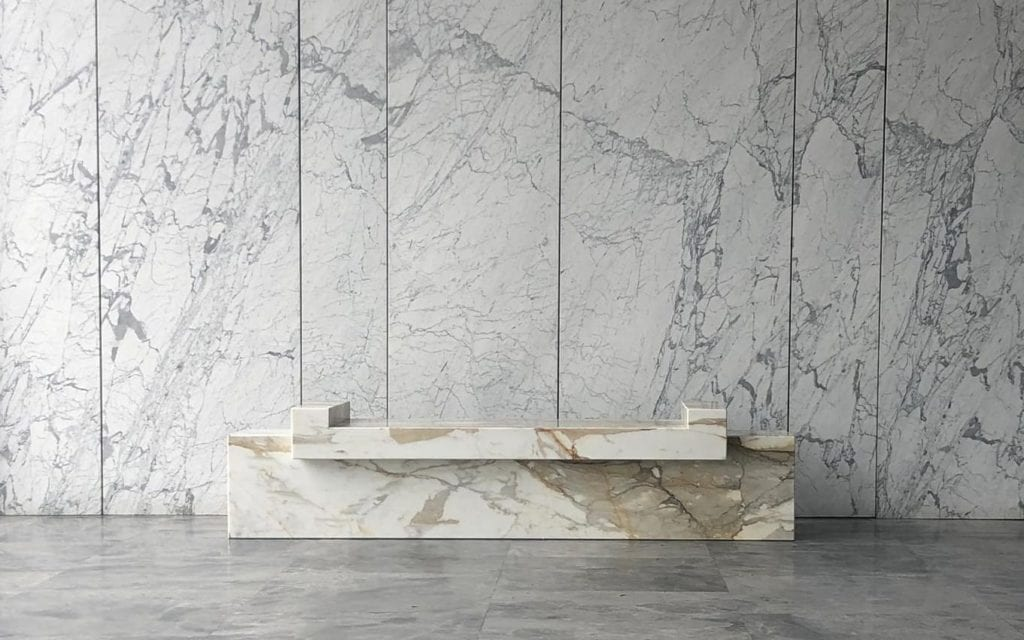 Reception desk in Calacatta marble