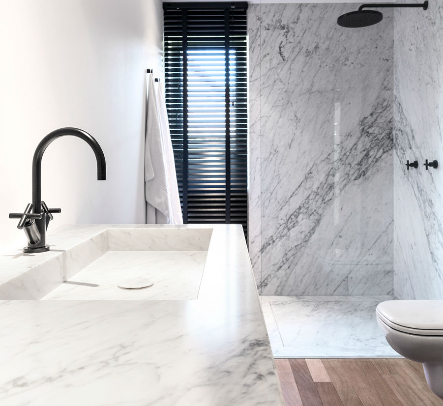 Luxurious stone bathroom vanity cut from a single slab of marble