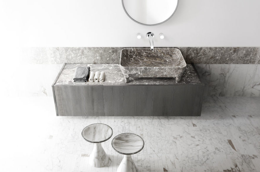 loto 2 sink in a stone bathroom with stone vanity and stools