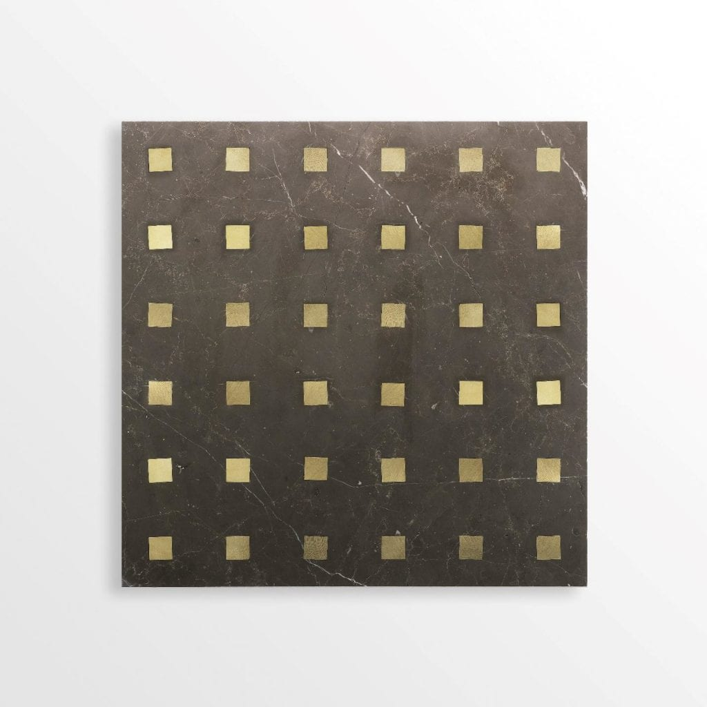 Dark stone backdrop with luxury gold inserts