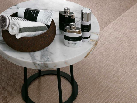 Bianco Calacatta marble Moon table with lotions and spa equipment set out
