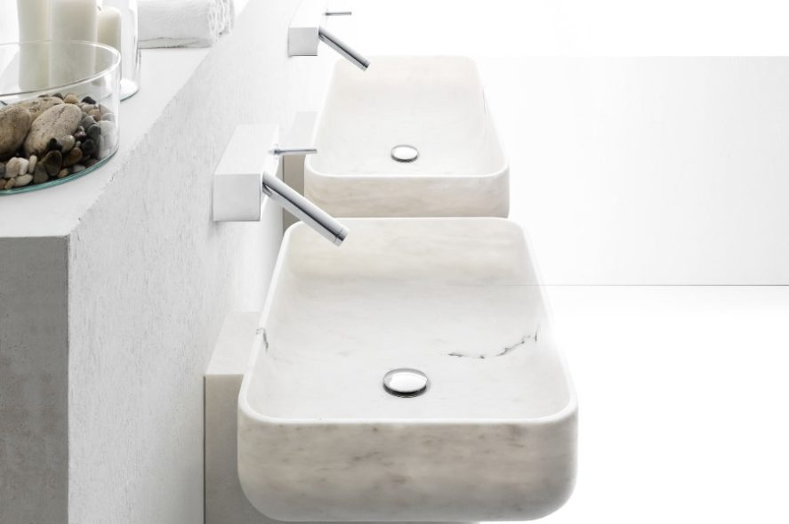 Italian white marble sinks on a stone vanity