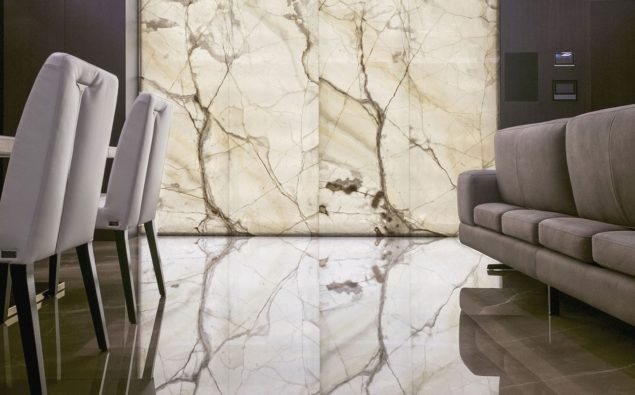 Interior living space with walls adorned with slabs of white onyx