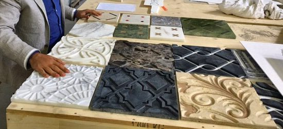 A Kreoo designer considering stone tile colors and textures
