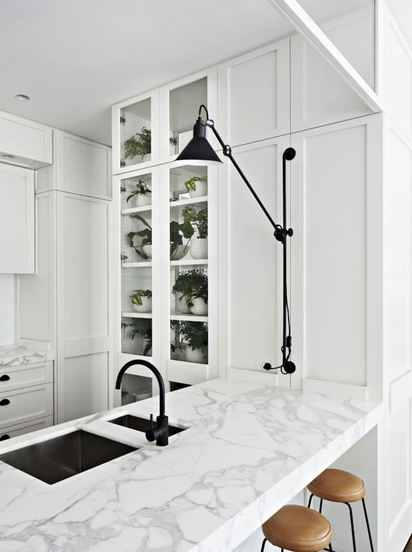 White marble with black accent traditional kitchen