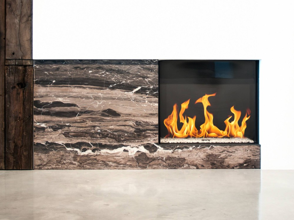A minimialist fireplace with cappuccino brown onyx