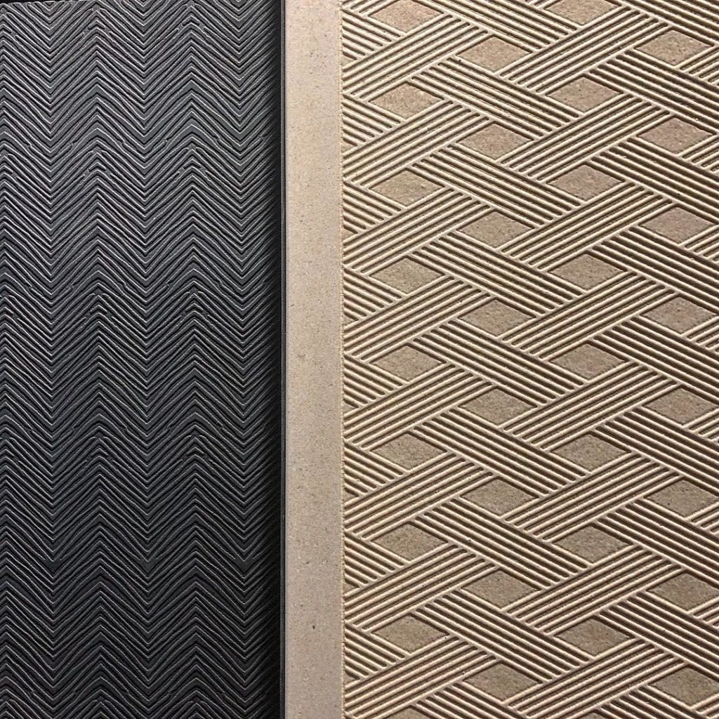Beige and black textured wall tiles with geometric patterns