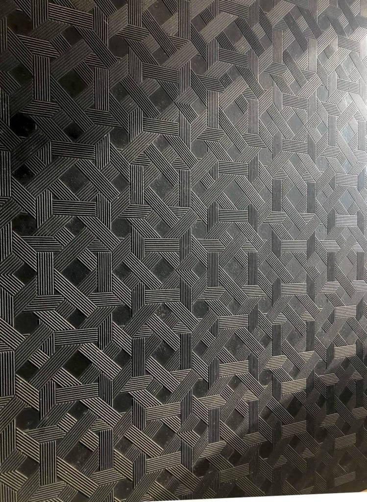 Black wall tiles with geometric textured pattern