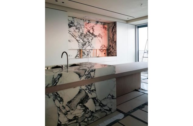 Custom marble cabinets with white and black marble